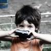 copil aparat foto